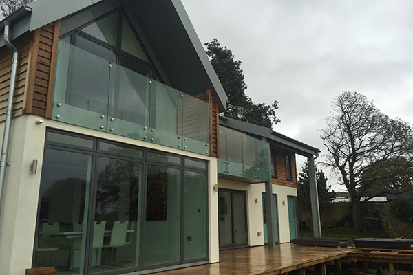 Bi-folding glazing and balustrade glass